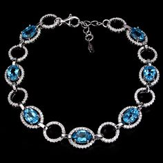 """Stunning 7x5mm oval swiss blue topaz (7) surrounded by micro pave cubic zirconia set in sterling silver.  This amazing bracelet is 8"""" with the additional chain so it can fit on any length wrist.  The perfect gift for the December birthday person on your list!"""