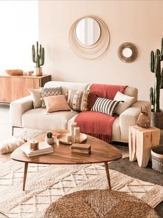 Boho living room featuring Berber rug, bamboo mirror, mid century coffee table, houseplants and neutral colours Boho Living Room, Living Room Interior, Home Interior Design, Home And Living, Living Room Decor, Bedroom Decor, Style Deco, Living Room Inspiration, Elle Decor
