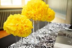 Save money on wedding flowers. Use tissue paper pom poms placed on top of vases.