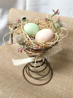 DIY Bed Spring centerpieces from raffia and floral supplies