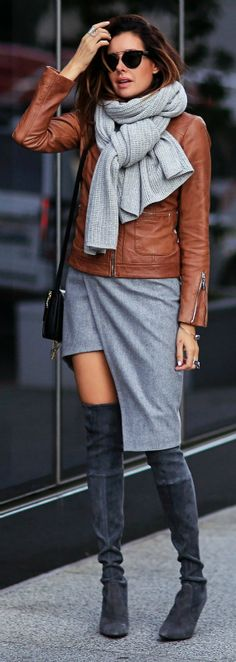 Wearing over the knee boots with an edgy asymmetrical wrap skirt like this one can create an alternative, trendy look. Erica Hoida wears the style with a tan leather jacket and an oversized marl grey scarf. Jacket: Bernardo, Skirt: Mugler, Shoes: Stuart Weitzman, Scarf: Club Monaco, Bag: Chloe.