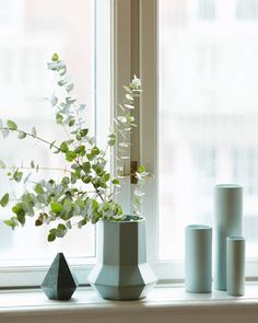 green / blue geometric vases in the window of a  Danish home. Hubsch.