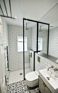 The aim for this bathroom was to create a space that looks and feels bigger and brighter. This was achieved with a simple black and white colour palette and bold fixtures and fittings, giving the space a unique appeal. Encaustic floor tiles from Fired Earth uses french inspired patterns giving a feminine touch and helps to zone the two areas whilst a crittall style shower screen defines the shower enclosure. Stainless steel accents enhance the look adding another dimension to the space
