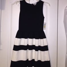 Black and White skater skirt dress super cute skater skirt dress! brand new with tags, but never had the chance to wear it. it's a medium but fits a 4-6 size. really hoping to just give it a new home, so make and offer and we can get a great deal!:) Bar III Dresses Midi