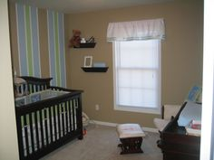 Maybe do light blue and dark blue for the stripes with red accents. http://www.roomzaar.com/rate-my-space/Nurseries/Baby-boys-room/detail.esi?oid=458358