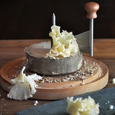 A Wheel of Ghoast Cheese + Ghoast Maker - this cheese shaving device has roots in 18th century France, and creates perfect ruffled curls (or ghoasts) that heighten its flavor.
