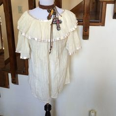 Darling Authentic Mexican Blouse w Ribbon accent Cute Mexican Blouse made of gauzy 100% Cotton with cream ribbon accent a ruffle collar and sleeve hand wash in cold water but so cute Tops Blouses