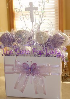 Communion Cake Pop Centerpieces Purple And White Round Lollipop Communion Centerpieces, Communion Favors, Communion Dresses, First Communion Party, Baptism Party, First Holy Communion, Baptism Ideas, Purple Cake Pops, Purple Cakes