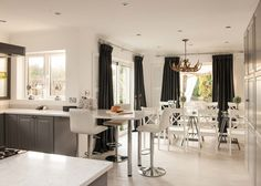 Modern white kitchen and dining room at Coral Beach House, Luxury Beach House Rental in Angmering-On-Sea, West Sussex