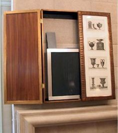 wall-mounted cabinets adorned with photos or art to hide flat-panel TVs.