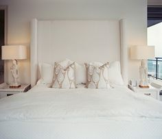 {Master Bedroom: A custom-made an oversized headboard to really anchor the space and compliment the height of the windows.}