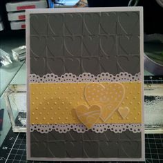 handmade valentine ... yellow and gray with white mat and lacy borders ... clean and simple design ... embossing folder hearts texture ... trio of stamped yellow hearts on matching yellow band ... luv it!