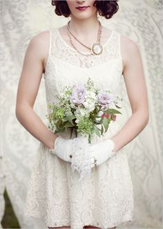 fun short lace dress, note the vintage pearls and cameo