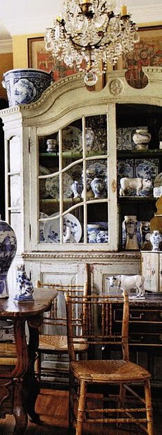 Love the blue and white porcelain and the gray grande dame of a cabinet