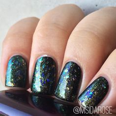 Fair Maiden Polish - Crystal Ball | a shimmer topper of gold to green color-shifting shimmer and various iridescent flakes, swatched over black