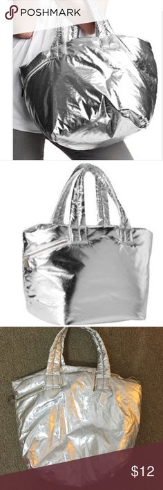 """Gap silver bag Amazing! Super lightweight and feels like a puffer jacket. Gorgeous deep cobalt blue lining and small zipper pouch. Rare find! 18.5""""X11. Strap drop 7.5"""". The first 2 photos are stock photos from gap. Gap Bags"""