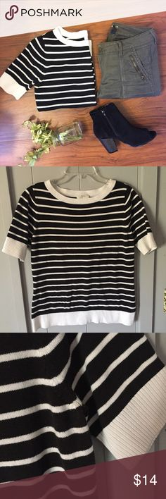 """Ann Taylor Loft Black and White Striped Sweater What I love about AT is the quality and classic style over time! This is a medium weight short sleeve sweater that is easy to throw on with any jean, add booties and a cute bag and you're set! Cotton blend. Slightly off-white (oyster, not cream.) ▪️19"""" armpit to armpit flat across and 25"""" shoulder to hem length. The last photo shows some dark jean transfer on the inside of back bottom hem- does not show when on! LOFT Sweaters"""