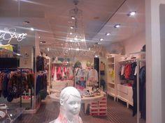 Kidspace store on Via Mazzini in Forte dei Marmi, Italy. Swarovsky chandelier Fall of Evi Style designed by Carmen Andretta.