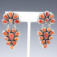 Earrings   Noah Pfeffer (Anglo).  Sterling silver and Spiny Oyster Shell