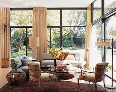 Trina Turk's living room- Edward Wormley for Dunbar sofas, a Richard Neutra cocktail table, and von Nessen floor lamp #decor #homedesign