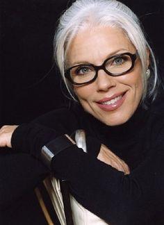 black eyeglass frames with the white hair