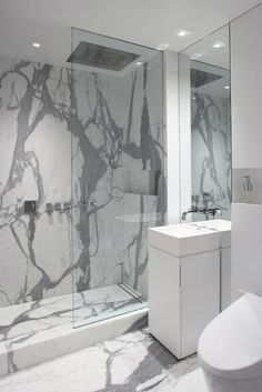 Magdalena Keck Interior Design: Stunning modern bathroom design with slab marble floors and shower. Exquisite gray ...
