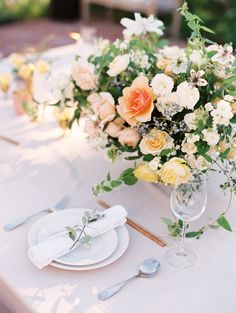 Centerpiece in Peach and Yellow | photography by http://claryphoto.com/