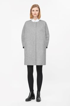 Made from felted wool-mix, this round-neck coat has a curved back seam for a softly structured shape. An oversized fit with in-seam side pockets, it has 7/8 kimono sleeves, hidden front zip fastening and modern raw-cut edges.