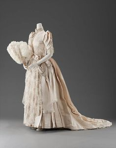 Circa 1889 Wedding Dress made of Silk Faille, Net, and Machine Bobbin Lace Embroidered with Pearls, American.