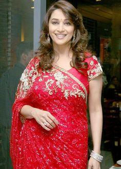 Madhuri can give jitters to the latest fashion divas! Saree being a favorite garment. Lets us look at Some Images Of Madhuri Dixit in Sarees. Beautiful Bollywood Actress, Most Beautiful Indian Actress, Indian Bridal Outfits, Indian Dresses, Bollywood Saree, Bollywood Fashion, Red Saree, Indian Bollywood, Madhuri Dixit Saree