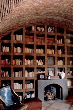 Architecture Jacques Chevalier - like the circular brick ceiling, the brick bookshelves.