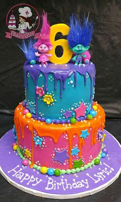 TROLLS BIRTHDAY CAKE No stars, no orange drip, flowers on both layers, different poppy and branch, add satin & chenille, swirly rainbow suckers (not the round ones)