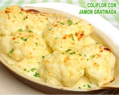 coliflor con bechamel, jamón serrano y queso