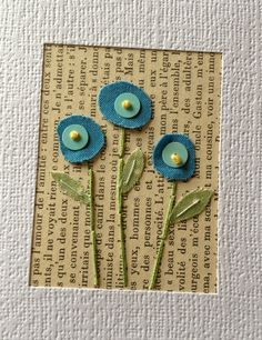 Combing a page backing with stitched stalks and circles of fabric to make flowers.