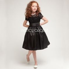 Black Classy Lace Sleeve Satin Girl Dress: This black party dress is perfect for any little girl looking to arrive in style this season. The laced bodice with sleeve decorated with floral embroidery is something to boast about alone. The adorable waistline is adorned with an attached layered satin sash that feats an overall elegant look complementing the satin classy skirt! The black dress would not only be a perfect party dress for a black tie wedding but can also be a great graduation…