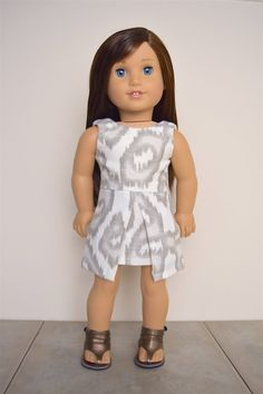 White and gray pleated dress by EliteDollWorld on Etsy. Made following the Inspired By Zooey Dress on Etsy. Get it here http://www.pixiefaire.com/products/inspired-by-zooey-dress-18-doll-clothes. #pixiefaire #inspiredbyzooey