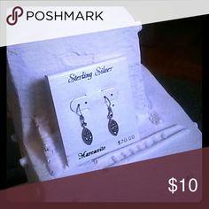 Sterling silver hanging earrings Very pretty diamond-shaped wire earrings, sterling silver. Not my style. Jewelry Earrings