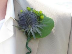 Boutonnieres out of thistle and hypericum berries. All my friend's vision!