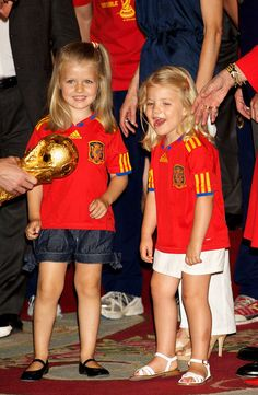 Princess Leonor (L) and Princess Sofia of Spain are shown the trophy while while the 2010 FIFA World Cup winning team Spain are received by the Spanish royal family at Zarzuela Palace on July 12, 2010 in Madrid, Spain.