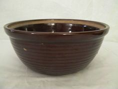 Just like mine but I found a green one. Vintage Western Brownware Old Monmouth Stoneware Brown Ribbed Mixing Bowl | eBay $20.00
