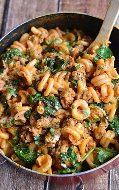 One pot spinach, sausage, roasted red pepper and goat cheese pasta.