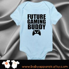 "Cute ""Future Gaming Buddy"" Little Boy's Onesie, Preferred Size: 6-12 Mo., Preferred Color: Red, Current Cost: $13.55+, Web Address: https://www.etsy.com/listing/220023825/future-gaming-buddy-baby-clothes?ga_order=most_relevant&ga_search_type=all&ga_view_type=gallery&ga_search_query=baby%20clothes&ref=sr_gallery_35"