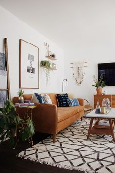 This is what I dreamed my house would look like when I grew up, modern wood furniture, plants, and macrame hanging with a gorgeous rug I love the feel of. I think I complete rearrange is on the horizon