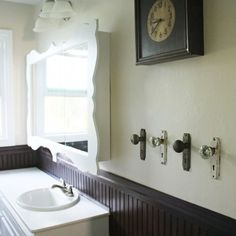 Using old door handles for towel hooks would be incredible. Also, hanging a hand towel through a door handle would match too:)