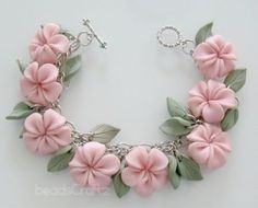 Pink Plumeria Garden Bracelet Polymer Clay by MadelineKdesign Polymer Clay Flowers, Fimo Clay, Polymer Clay Projects, Polymer Clay Creations, Clay Beads, Clay Crafts, Polymer Clay Bracelet, Polymer Clay Charms, Polymer Clay Art