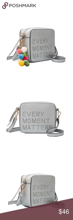 Celine Quote Crossbody Melie Bianco  Premium Vegan Leather Middle Zipper Interior Slim Pockets Interior Zipper Pocket Back Zipper Detachable Pom Pom Included Dimensions 7'L x 3'W x 6H' Colors: Silver Melie Bianco Bags Crossbody Bags