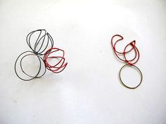 Michal Oren  Impossible red rings and smashed flower  2010  silver and industrial paint