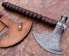 HANDMADE DAMASCUS STEEL AXE Overall Length:16.5 inches   Handle Material:  Handle made of Natural Wood  Blade Hardness: 56-60 HRC  THE BLADE  THIS IS A BRAND NEW KNIFE. THIS KNIFE DAMASCUS STEEL BLADE