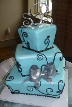 i like the idea...but id rather it be a white cake with purple outlining,...i still like the silver bow though and the topper