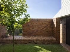 Double Courtyard House » Vokes and Peters Brick bench seat and green grass.